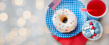 Donut with juice and candies on independence day Royalty Free Stock Images