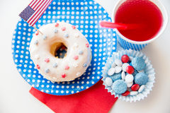 Donut with juice and candies on independence day Stock Images