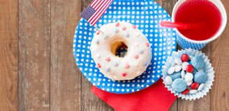 Donut with juice and candies on independence day Stock Photography
