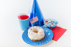 Donut with juice and candies on independence day Royalty Free Stock Photos
