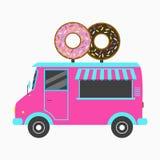Donut-LKW Schnellimbiß Bäckereipackwagen mit Schild in der Form von zwei geschmackvollen Schaumgummiringen Auch im corel abgehobe Stockfoto