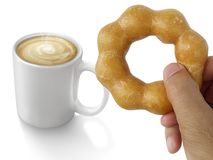 Donut in man`s hand and Hot coffee isolated on white background Royalty Free Stock Photo