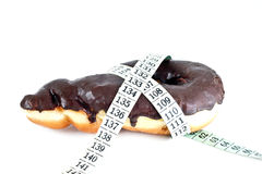 Donut with measuring tape Stock Image