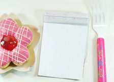 Donut and Notepad. A Delicious Donut , Notepad, Fork stock image