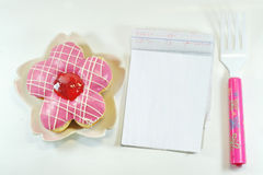 Lovely Message. A Delicious Donut , Notepad, Fork stock images