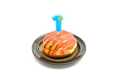 Donut with one years birthday candle Royalty Free Stock Images