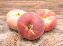Donut peaches isolated on wooden background Stock Photography