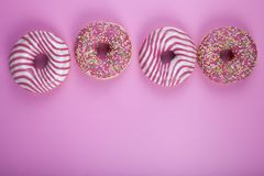 Donut on a pink background stock photography