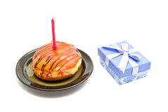 Donut with pink birthday candle and gift Stock Photography