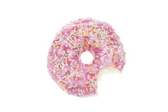 Donut with pink glaze and bite isolated Stock Photography