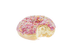 Donut with pink glaze and bite isolated Royalty Free Stock Image