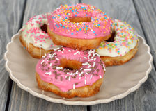 Donut with pink icing Royalty Free Stock Photo