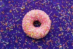 Donut pink icing background purple space for text Stock Images
