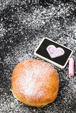 Donut with powdered sugar and heart drawing. Copy space royalty free stock photos