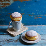 Donut in powdered sugar Royalty Free Stock Images