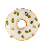 Donut with pumpkin seeds. Bagel with pumpkin seeds served with cream cheese white background royalty free stock image