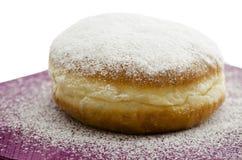 Donut on purple napkin Royalty Free Stock Images