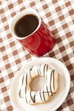 Donut and red coffee cup Stock Images