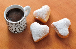 Donut in the shape of heart and coffee Royalty Free Stock Image