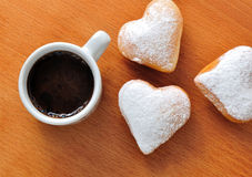 Donut in the shape of heart and coffee Stock Photo
