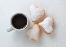 Donut in the shape of heart and coffee Stock Images