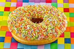 Donut and sprinkles Stock Photo