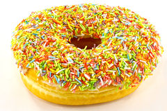 Donut and sprinkles Royalty Free Stock Photo