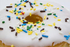Donut with sprinkles closeup Stock Photography