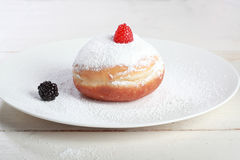 Donut or Sufganiya. Hanukkah doughnut with jam and caster sugar Royalty Free Stock Images