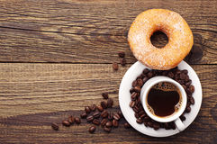 Donut with sugar and coffee Stock Images