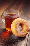 Donut with sugar and tea Stock Photography