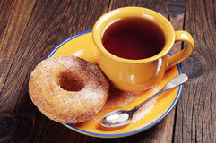 Donut with sugar and tea Stock Image