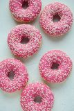 Donut. Sweet icing sugar food. Dessert colorful snack. Glazed sprinkles. Treat from delicious pastry breakfast. Bakery cake. Dough royalty free stock photography