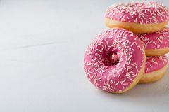 Donut. Sweet icing sugar food. Dessert colorful snack.Treat from delicious pastry breakfast. Bakery cake. Doughnut with frosting. Baked unhealthy round on a stock photography