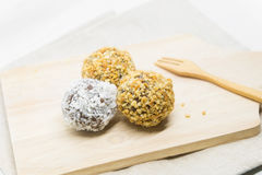 Donut sweetmeat on dining table. Sphere donut sweetmeat on dining table Royalty Free Stock Photo