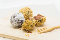 Donut sweetmeat on dining table. Sphere donut sweetmeat on dining table Royalty Free Stock Image