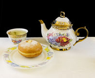 Donut and teapot Royalty Free Stock Image