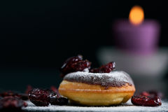 Donut topped with chocolate and cranberries Royalty Free Stock Photos