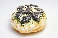 Donut with oreo & cheese topping royalty free stock photography