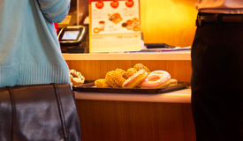 Donut on tray in counter shop, warm tone color, soft focus Royalty Free Stock Photography