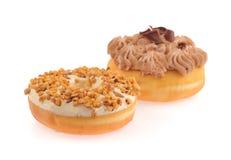 Donut und Brot mit der gepeitschten Schokolade wirbelten Stockbilder