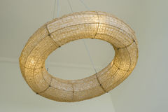 Donut warm lamp made from a rattan hanging on ceiling,interior design Stock Photos