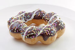 Donut on white dish. Close up Royalty Free Stock Photography