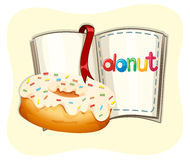 Donut with white frosting and book Stock Photo