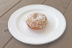 Donut on white plate Royalty Free Stock Image