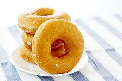 Donut  on a white plate. In white background Royalty Free Stock Photography