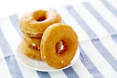 Donut  on a white plate. In white background Stock Images