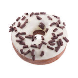Donut in wight chocolate with chips. A single wight chocolate glazed donut with chocolate chips isolated white background royalty free stock images