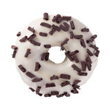 Donut in wight chocolate with chips. A single wight chocolate glazed donut with chocolate chips white background stock photo