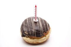 Donut With Birthday Candle Royalty Free Stock Photography